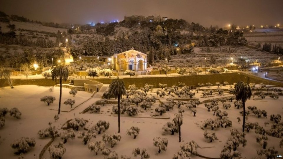 Snow covers the area around the Church of All Nations in the Garden of Gethsemane, in east Jerusalem