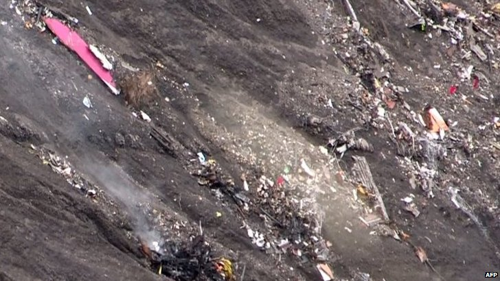 A screen grab taken from AFP video shows debris at the Germanwings crash site in the French Alps