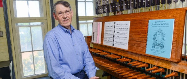 Dr. Richard Shadinger in front of the carillon system.