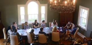 Students sit with Hart and Clark at the first entertainment roundtable