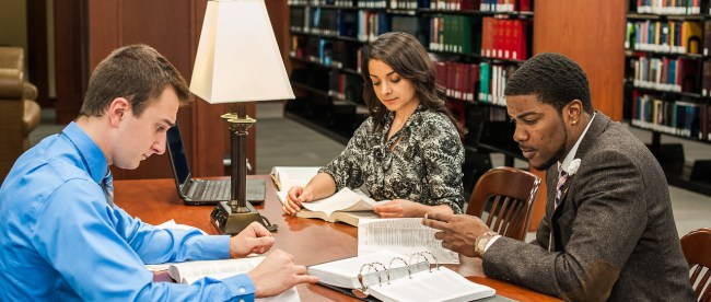 Law students studying in library 2015