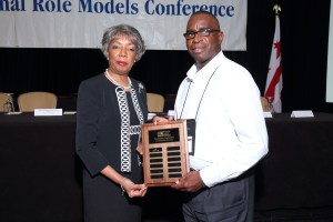 Gary Hunter accepts Belmont's award at the National Role Models Conference.