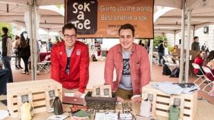 Two student entrepreneurs presenting their company at Belmont's Entrepreneurship Village event