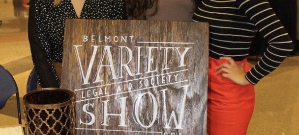 Students standing around the variety show sign