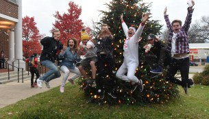 Students jump in front of the Christmas Tree at Blizzard on the Blvd.