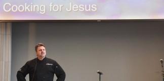 Brett Swayn speaks to students at chapel