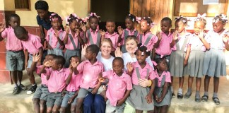 Whitwell and Beggs surrounded by children in Haiti