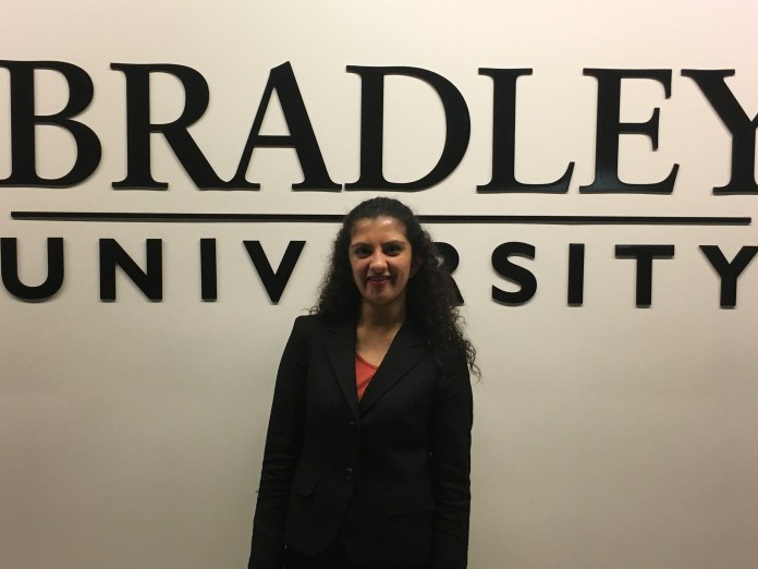 Shukla poses for a photo at Bradley University, the institution where the tournament was held.