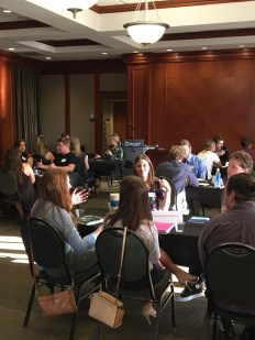 Attendees speak with industry experts at a recent event where professionals shared advice with soon-to-be-grads