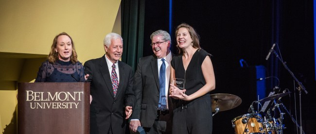 ABC accepts their award on stage at the President's Concert.