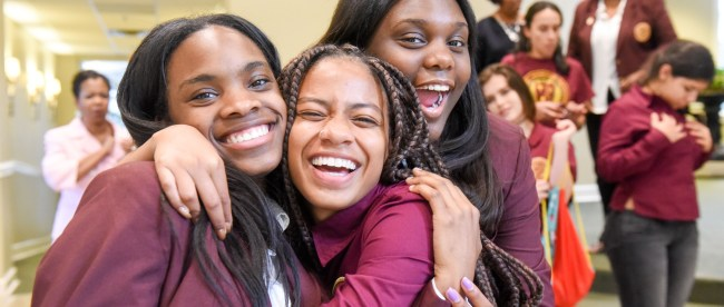 Young women from the Leadership Academy pose together for a photo.