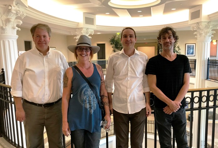The photo shows L-R CSM dean Dr. Thom Spence, Dean of the College of Sciences & Mathematics, Paula Fairfield, Dr. Scott Hawley, Physics professor, and Rob McClain, owner of OmegaLab studio and former Belmont student.