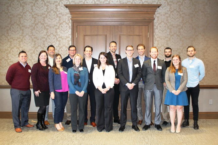 Graduates from the program pose in the Massey Boardroom