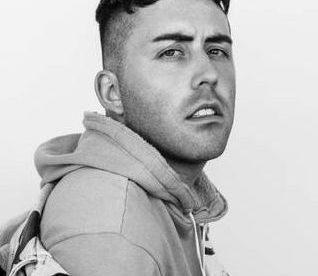 Brett McLaughlin headshot, black and white