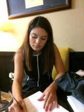 Crystal Lemus writing at a desk