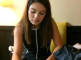 Crystal Lemus writing at a desk