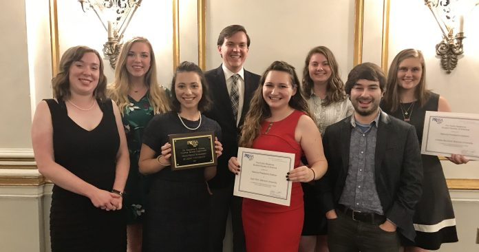 Members of PRSSA Executive board holding their awards