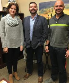 A photo, taken in a Belmont faculty member's office, of Drs. Vaughn, Webb and Fyke