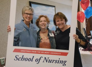 Dean Taylor and two other faculty members pose with the School of Nursing photo frame at the School's 45th anniversary celebration.