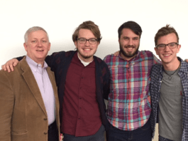 Dr. Darrell Gwaltne, Randy Westergaard, Cole Fuller, and Taylor Brown standing in a classroom