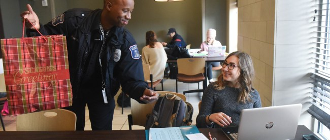 Malcolm McDole of Belmont security hands out Christmas cheer at Belmont University in Nashville, Tennessee, December 7, 2017.