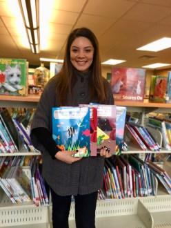 Crystal Lemus holding her books