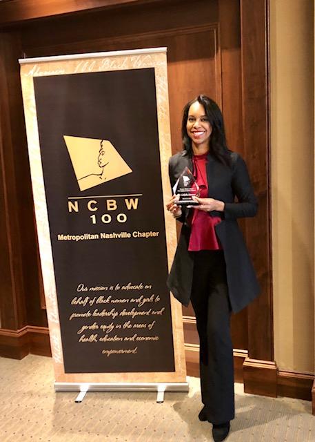 Lakisha Simmons posing with her award