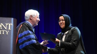 Khadija Ali Amghaiab accepts the Fourth Year Leadership Award