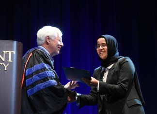 Khadija Ali Amghaiab accepts the Fourth Year Leadership Award