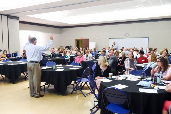 Dr. Jesse Register speaks to area teachers and Administrators during the CIES Emerging Knowledge Forum at Belmont University in Nashville, Tennessee, June 7, 2018.