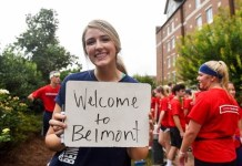 "Photo of student holding ""Welcome to Belmont"" sign at Move In"