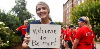 """Photo of student holding """"Welcome to Belmont"""" sign at Move In"""
