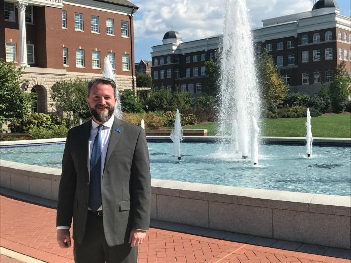 Philip Phillips next to Belmont fountain
