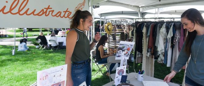 Then senior Suzanna Stapler shows off the products of her company Squillustrate at Belmont's annual Entrepreneurship Village event in May 2018.