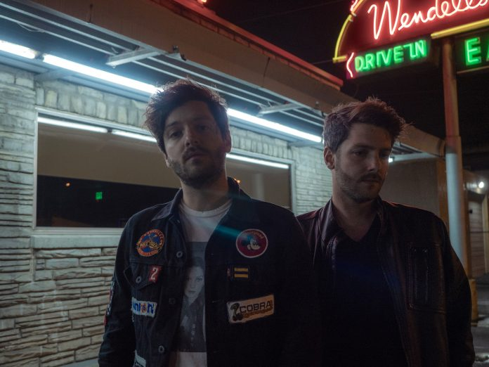 Twin brothers of pop/rock band Ponce pose for photo