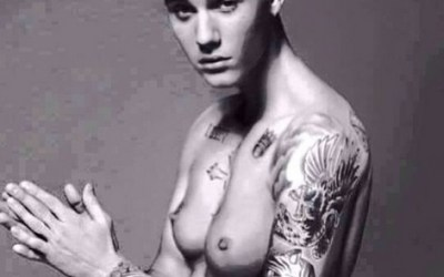 Pic of Justin Bieber with Fake Boobs uploaded by Miley Cyrus