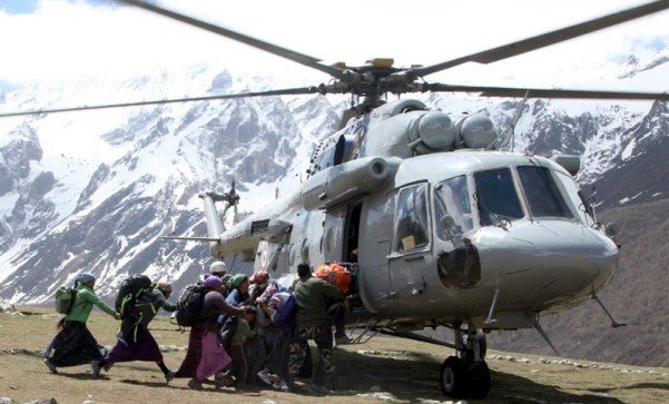 Local Nepalese and Army persons being evacuated by An Indian Air Force (IAF) Mi-17 V5 helicopter of directions of Nepalese authority as part of relief & rescue operations following a recent massive earthquake in Nepal