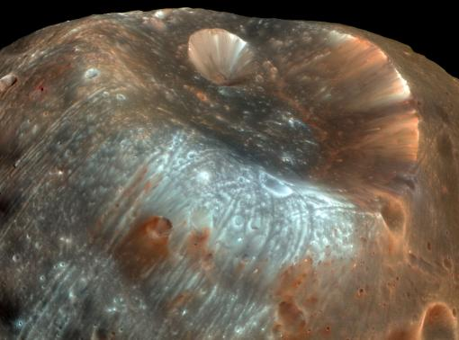 A mysterious little rock in its own right - The Martian moon Phobos has accumulated dust and debris from the surface of Mars, knocked into its orbital path by projectiles colliding with the planet. A sample-return mission to Phobos would thus return material both from Phobos and from Mars.