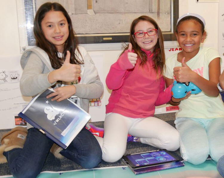 Fifth grade girls team prepares to compete at Wonder League Robotics.