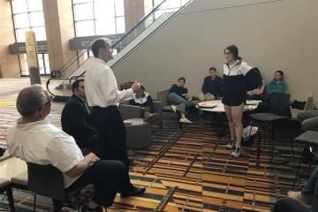 Judge John Madden offering feedback to Erin McCoy as students enter National Mock Trial competition today