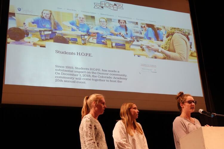 From left: Gretchen Carpenter, Emily Dawson, Aly Gallagher launch Hope 25 at an Upper School Town Hall on September 26.