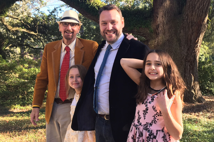 Chris, with son Cedar and two granddaughters