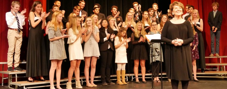 Students join the audience applauding Cindy Jordan at the end of her final concert in Froelicher Theatre.