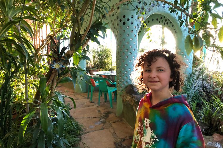 Rachel Meltzer enjoying the indoor plantscape. Photo by Adam Meltzer