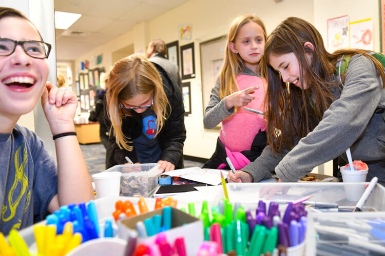 Middle School students helped with art-making stations around the All-School Arts Festival.