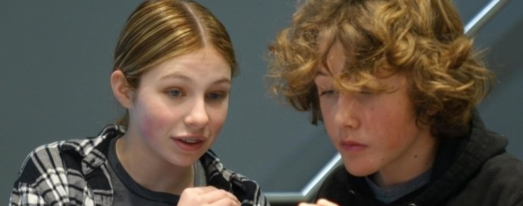 Seventh Graders Margie Timmers and Jack Ege prepare for the final debate round.