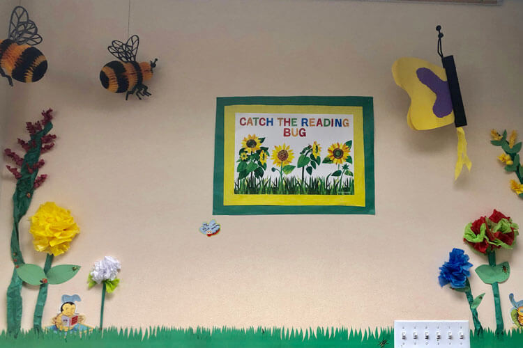 Soon, this garden wall will be filled with the current favorite books of our Lower School readers.