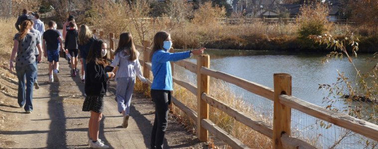 Middle School advisories visit Woodys Pond to look for birds.