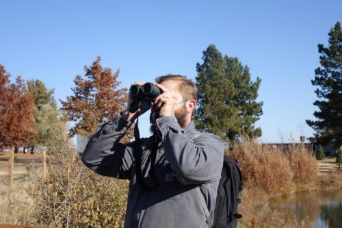 Ian Marzonie leads a group of Middle Schoolers on a bird watching outing.