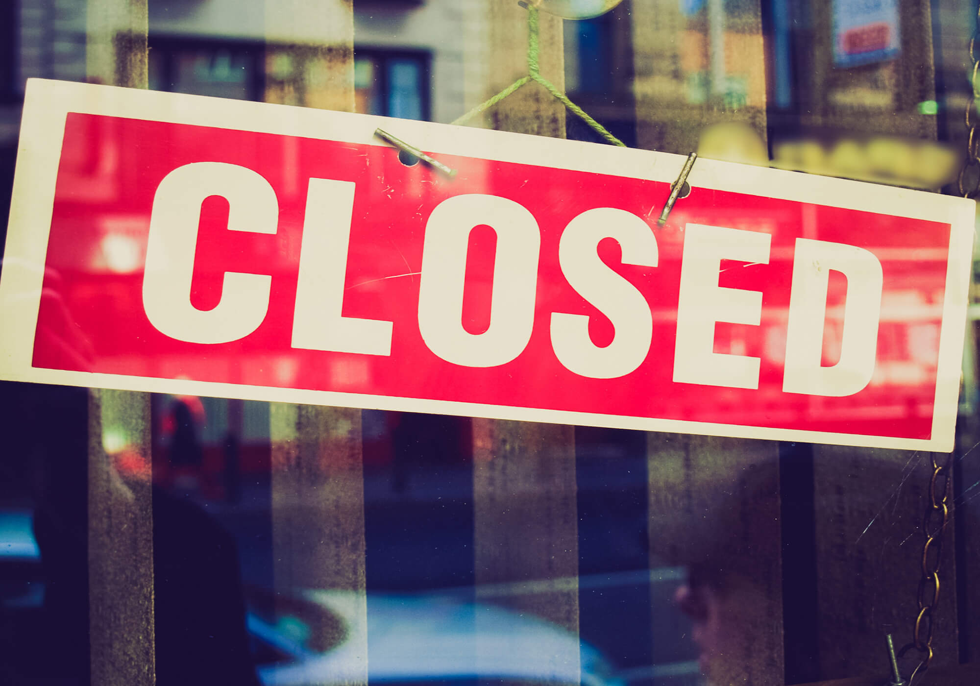 closed sign red in window